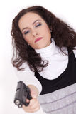 Woman with gun aiming Royalty Free Stock Photography