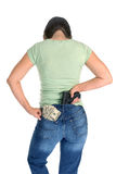 Woman with gun and cash Royalty Free Stock Photos