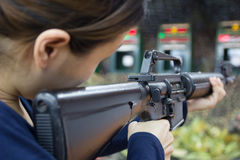 Woman and gun fire Royalty Free Stock Photography