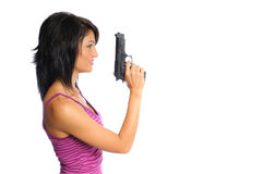 Woman with gun in hand. Attractive hispanic woman profile holding a pistol on a white background Royalty Free Stock Image