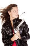 Woman with gun looking to side Stock Photography