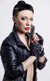 Woman with a gun Royalty Free Stock Photo