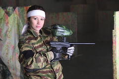 Woman with gun for paintball Royalty Free Stock Photography