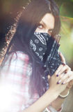 Woman with gun portrait Stock Photo