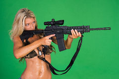 Woman with Gun. Sexy woman with AR15 rifle Royalty Free Stock Photography