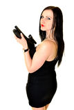 Woman With Gun. Studio portrait of young woman with gun Royalty Free Stock Photography