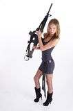 Woman with gun on white Royalty Free Stock Photo