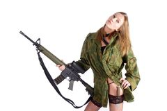 Woman with gun on white. Beautiful sexy blond woman holding army rifle Stock Image