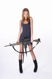 Woman with gun on white. Beautiful sexy blond woman holding army rifle Royalty Free Stock Photography