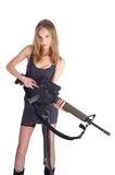 Woman with gun on white. Beautiful sexy blond woman holding army rifle Royalty Free Stock Image