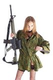 Woman with gun on white. Beautiful sexy blond woman holding army rifle Stock Images