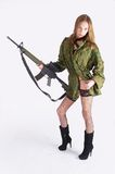 Woman with gun on white. Beautiful sexy blond woman holding army rifle Stock Photography