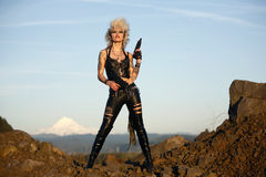 Woman with guns royalty free stock image