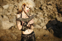 Woman with guns Stock Image