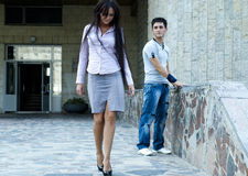 Woman and a guy. Photo of business woman and a guy in torn jeans Stock Image