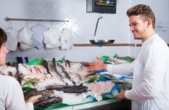 Woman  and guy selecting fish Stock Photo