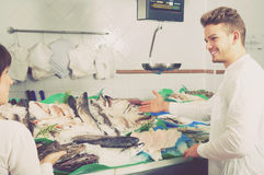 Woman  and guy selecting fish Stock Photography