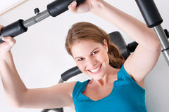 Woman in gym Royalty Free Stock Image