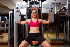 Woman in gym Stock Images