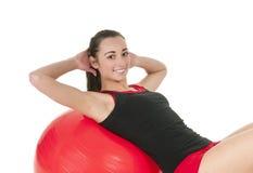 Woman with gym ball Stock Image