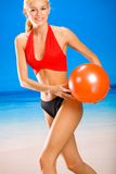 Woman with gym-ball on beach Royalty Free Stock Photo