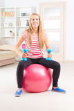 Woman with gym ball Royalty Free Stock Photos