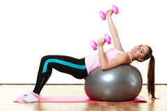 Woman with gym ball and dumb bells isolated Royalty Free Stock Photo