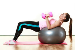 Woman with gym ball and dumb bells isolated Royalty Free Stock Photography