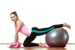 Woman with gym ball and dumb bells isolated Stock Images