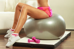 Woman with gym ball and dumbbell doing exercise royalty free stock photos