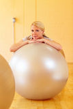 Woman with gym balls Royalty Free Stock Photography