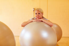 Woman in gym with balls Stock Photos