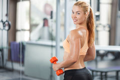 Woman in the gym with barbell Royalty Free Stock Image