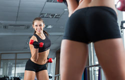 Woman in the gym with barbell Stock Image