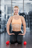 Woman in the gym with barbell Stock Photos