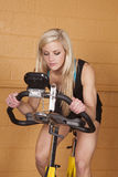 Woman gym bike looking down Stock Photos