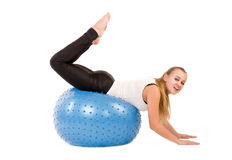 Woman in gym with a blue ball Royalty Free Stock Photo