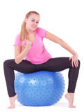Woman in gym with a blue ball Stock Photography