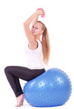 Woman in gym with a blue ball Royalty Free Stock Image