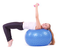 woman in gym with a blue ball Stock Image