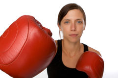 Woman in gym clothes, with boxing gloves, strength Royalty Free Stock Image