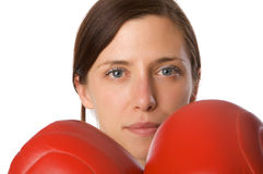 Woman in gym clothes, with boxing gloves, strength Stock Photo