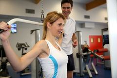 Woman in gym with coach Royalty Free Stock Images