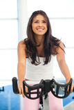 Woman at the gym cycling Royalty Free Stock Images