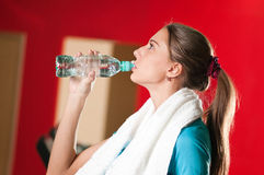 Woman at the gym drinking water Royalty Free Stock Images