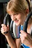 Woman at gym exercise fitness Royalty Free Stock Images