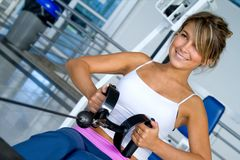Woman at the gym exercising Royalty Free Stock Photo