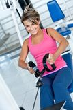 Woman at the gym exercising Stock Photos