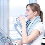 Woman at the gym exercising. Stock Images