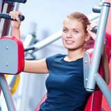 Woman at the gym exercising Stock Photo